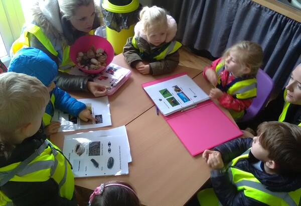 Before we went out to explore our wonderful coast line, The Children had to put on their thinking caps as we were in search of items on our journey down to the beach. Litter! I'm pleased to say there was no litter to be collected. We counted red cars, we searched for yellow flowers & we found the post box and posted letters! Lovely speech and language was observed, great counting skills too!  6 children get taken to the beach with three staff members - All children must wear reins and high vis jackets